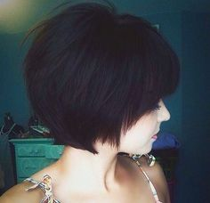 short angled haircut ~ This haircut is a godsend for thick hair! You can keep your natural volume and thickness w/o all the bulk and frizz. The layered pieces work together to form the wispy style.