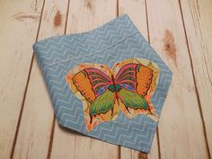 Beautiful Butterfly soars on sky blue Chevron.  This Collar Rap reverses to an orange and white modern paisley. Monogram can be added to top by CollarRap on Etsy