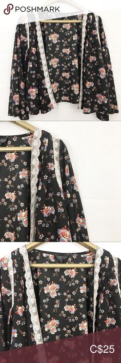 """TOPSHOP Shirt Open Front Floral Bell Sleeves Top TOPSHOP Women's Shirt Size 4 Black Floral 3/4 Bell Sleeves Open Front Lace Trim  -preowned -no stains, tears or holes -size 4 -black with floral pattern -open front -lace trim -bell sleeves -100% polyester  COLOR MAY BE SLIGHTLY OFF DUE TO CAMERA FLASH AND LIGHTING  Measurements: Shoulder to Shoulder:  14"""" Underarm to Underarm:  20"""" Sleeve length:  19"""" Length of top:  17.5"""" Topshop Tops Bell Sleeves, Bell Sleeve Top, Topshop Tops, Plus Fashion, Fashion Tips, Fashion Trends, Front Lace, Top Colour, Color"""