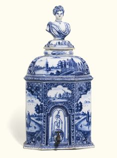 A rare Dutch Delft blue and white ater cistern and cover, circa 1750-1760