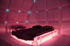 Bedroom with red lights at the Hotel de Glace, An Ice Hotel Quebec City, Canada