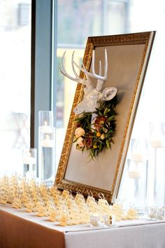 Decorate your place card display with a vintage frame, mounted deer head and wreath for a wintry wedding look. Budget Wedding Invitations, Wedding Planner, Winter Wedding Decorations, Baby Shower Fall, Fall Baby, Wedding Seating, Wedding Reception, Woodland Wedding, Woodland Baby