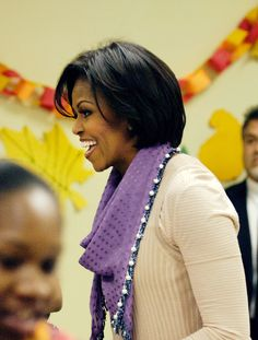 first lady michelle obama packs and give bags of food to area residents ahead of the