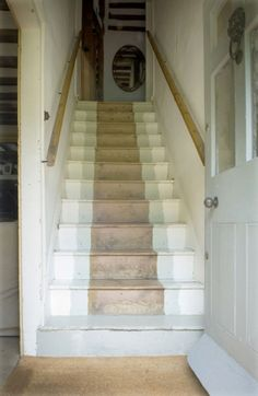 I like the way the staircase is painted in varying whites and greys