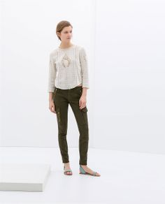 Image 1 of CARGO PANTS WITH SEAMS AND ZIPS from Zara