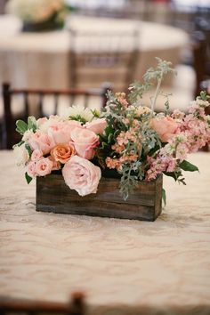 Centerpieces Blush Vintage Rustic centerpiece blush pink @Laura Jayson Jayson Raffo Little wooden crates for your centerpieces would be cute on the long farm tables!