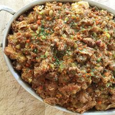 Sausage Stuffing. Photo: Ad Hoc Sausage Stuffing Serves 6 3 quarts dried Ciabatta bread, diced large 1 cup olive oil 2 tablespoons parsley, chopped 2 tablespoons sage, chopped 2 tablespoons rosemary, chopped Salt 2 tablespoons unsaltedbutter, diced 1 onion, diced ½ carrot, diced ½ celery, diced 2 cups