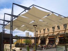 contemporary pergola with tensile panels