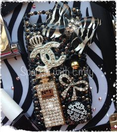 RHINESTONE/CANDY CASES  - Chanel inspired phone case - fits iPhone 5 - Swarovski Chanel logo, Zebra print bow, Silver crown, crystallised Perfume bottle, Anna Sui Glitter, Gold and Black Flower and sparkly bow  - Check out Sparkle with Emily for bespoke phone cases, Converse and lots more!