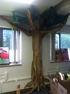 Weird Animals Classroom Tree Decoration - Made with tape, crinkled and cut craft/packing paper, and Green plastic tablecloth cut in 3 sections and draped from Ceiling. Cost about $2