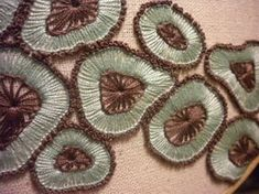 Cool rock formation looking embroidery.. so neat and the composition is wicked by KwilityKate on craftster