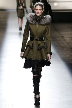 She looks kind of mad. No reason to in that FAB coat. Lighten up, doll. Check out the contouring on the cheeks. Prabal Gurung RTW Fall 2013 - Slideshow - Runway, Fashion Week, Reviews and Slideshows - WWD.com