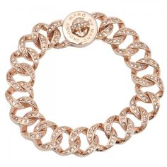 festive crystals light up this petite marc jacobs curb-link bracelet finished with a mk logo-etched turnlock closure.