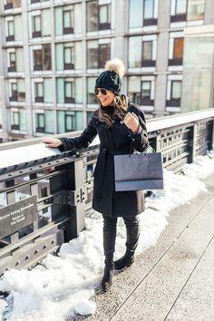 All black for NYFW bundled up on the Highline // Black wool coat, pom pom hat and otk boots
