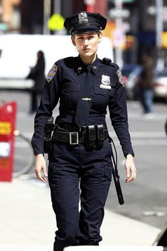 "Leelee Sobieski Photos - LeeLee Sobieski wears an NYPD uniform as she shoots scenes for her latest project, ""Rookies,"" in NYC. The actress, wearing a 'Perry' name tag, shot several scenes out on a sidewalk with a male co-star. - LeeLee Sobieski Films 'Rookies' in NYC"