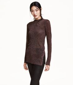 Fitted rib-knit top with multicolored glittery threads. Turtleneck, long sleeves, and slits in sides. Slightly longer at back.
