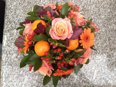 Tones of peach and orange, using roses, clementines, hypericum berries and gerbera by Judith Blacklock Flower School