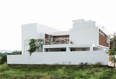 The Lateral House is a splendid paradigm in unique design ideologies and distinctive materialism by Gaurav Roy Choudhury Architects GRCA.The design takes its inspiration from modern contemporary ideas and innovative spatial design. The minimalist design interiors of the house along its innovative spatial design translates into timeless spaces.