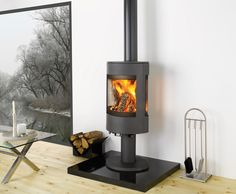 The has a stunning sleek modern design that would fit into any modern home. One of the great things about this stove is that it gives a great view of the flames through a large glass screen. This stove is also available as a wood burner and a multi Wood Burner Stove, Wood Burner Fireplace, Log Burner, Pellet Stove, Into The Woods, Contemporary Wood Burning Stoves, Contemporary Fireplaces, Solid Fuel Stove, Wood Fuel