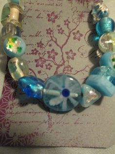 blue glass multi shaped beads ; silver lobster claw clasp product # 056b $15.00  sweetteabeads.com
