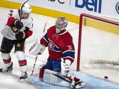 The shot by Ottawa Senators Erik Karlsson enters the net behind Montreal Canadiens goalie Carey Price as Ottawa Senators' Jean-Gabriel Pageau looks on during third period NHL hockey action on Tuesday.