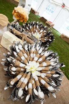 what a neat way to present wedding flatware http://event.thingsfestive.com/blog/burlap-flatware-create-gorgeous-tables/