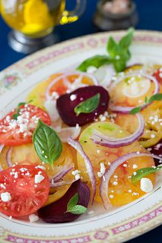 Heirloom Tomato Beets Salad with Basil, Red Onion & Feta Cheese http://www.melangery.com/2013/07/heirloom-tomato-beets-salad-with-basil.html by Yelena Strokin, via Flickr