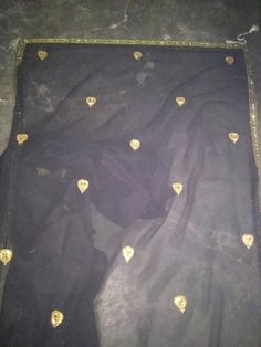 Hand embroidery on Beautiful black georgette Saree. For details please contact me... 9650101255.