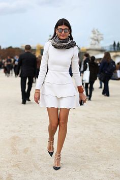 Giovanna Batalia in Valentino white scalloped tiered mini dress and Valentino studded two tone shoes