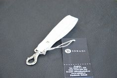 Breloc din piele naturala 2 -alb zapada -catarama metalica argintie -dimensiuni: L=11cm l=1,8cm  PRET: 15 Lei Lei, Personalized Items, Metal