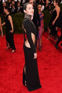 The Met Gala Looks That Did The Theme Proud #refinery29  http://www.refinery29.com/2015/05/86824/met-ball-2015-best-dressed-red-carpet-pictures#slide-27  As the reigning queen of not giving AF, Miley Cyrus did not stick with the Met Gala theme last night. Instead, she strolled in wearing a studded, high-neck, Alexander Wang dress. Frankly, that's the way we like to see her.For A Similar Style Try: