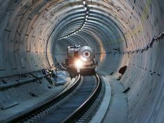 1,200 workers are spending 24 hours a day converting the underground tunnels, some of them 130 feet below the surface, into actual train tracks.
