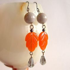 LOVE THE ORANGE!!  NEED TO MAKE SOME FOR MYSELF..........Orange Gray Leaf Dangle Earrings Vintage Plastic Glass by skeptis