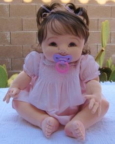 Baby girl with magnetic pacifier (Fair/Light complexion)