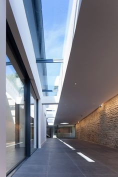 Medieval church hall renovation features light-filled extension and glazed walkway