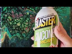 What happens if you spray silicone on a painting? - YouTube