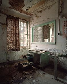 """The walls were peeling, revealing the words they had attempted to hide beneath coats of paint. The drawers had been searched and emptied, their useless contents scattered on the floor ..."""
