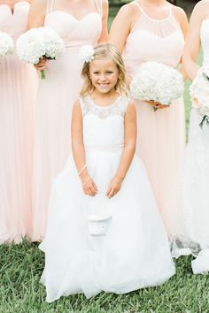 Flower girl fashion, white dress, little wicker basket, white flower hair accessory, tulle skirt, loose blonde curls // Rachel Red Photography