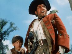 "Bobby Driscoll as Jim Hawkins and Robert Newton as Long John Silver in Walt Disney's ""Treasure Island"" Based on the classic novel by Robert Louis Stevenson. Long John Silver, Robert Louis Stevenson, Disney S, Disney Movies, Walt Disney Treasures, Bobby Driscoll, Robert Newton, Jim Hawkins, Leagues Under The Sea"