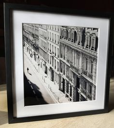 TITLE Rue de Chabrol  In stock, ready to ship!  A professionally framed print of a Parisian street with all its gorgeous detail. Who doesnt love to stroll the streets of Paris in spring? PRINT ORIENTATION :: PRICE square :: $89  MORE PARIS :: http://etsy.me/1NkYSvS  THE DETAILS :: 12x12 pro grade silver halide photo print :: 16.25 x 16.25 x 1.25 solid wood frame :: ultra-clear museum-quality plexi-glass :: extra thick white mat :: ready to hang with hardware installed :: in sto...
