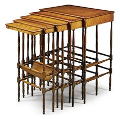A nest of five Regency mahogany and specimen wood tables, in the manner of Gillows of Lancaster circa 1815 each with a crossbanded top in various timbers including satinwood, rosewood and amboyna, on slender turned legs joined by conforming stretchers, the smallest table with a chess board top and fitted with a frieze drawer with a bowed undertier