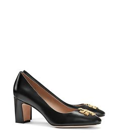 """Tory Burch Raleigh Pump in black/gold - Smooth black leather gives our Raleigh Pump the right amount of everyday polish. A versatile silhouette that easily dresses up or down, it features a graphic, streamlined take on our signature double-T logo and a chic Sixties-style block heel. 2.79"""" (7.0 cm) covered heel Resina leather upper Metal double-T logo at toe Leather lining Leather sole"""