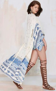 Festival season is almost upon us! Pair a simple t-shirt, jean shorts, gladiator sandals, and printed kimono