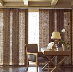 For Jamie B. Sliding panel blinds for the sliding door leading to deck. The brand at the house in Batavia is Comfortex Window fashions.