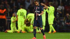 dejectedof PSG walks up the pitch as Luis Suarez of Barcelona celebrates scoring their second goal