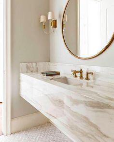 White and gold bathroom with marble floating vanity. Chic bathroom boasts a grey and white marble floating vanity sink, suspended over a marble mosaic . Modern Luxury Bathroom, Bathroom Design Luxury, Beautiful Bathrooms, Bathroom Interior, Minimal Bathroom, Marble Interior, Bath Design, Bathroom Furniture, Modern Marble Bathroom