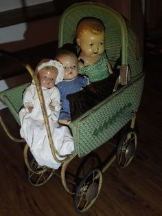 The dolls I got at an estate sale. The doll carriage I bought an antique store. At home, said, I hoped it wasn't going to be like that clown toy in the commercial. Later, husband tied a string on it and started pulling it in the dark as I got up. I could hear it's squeaky wheels and see it moving. He really got me good on this one!