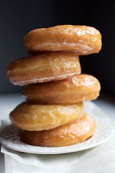 Vanilla-Glazed Yeast Donuts Recipe (Saveur) | The glaze on these airy donuts achieves its satiny consistency thanks to a combination of clarified butter and evaporated milk.