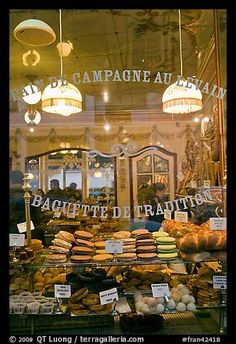 Pastries in bakery storefront. Paris, France