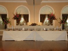 Elegant head table for a great bridal party.  Striking colors!